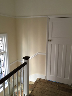 Decorating landing stairs door after